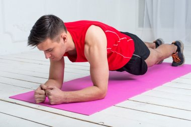 fitness training athletic sporty man doing plank exercise in gym or home concept exercising workout aerobic