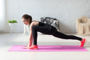 Women doing exercises aerobics warming up with gymnastics for flexibility leg stretching workout at home fitness