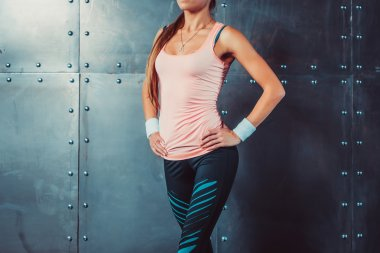 Sportswoman showing perfect female body in sports clothing sportswear concept sport healthy lifestyle.