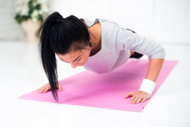 teenage girl doing push ups warming up working at home fitness, sport, training, diet and lifestyle concept