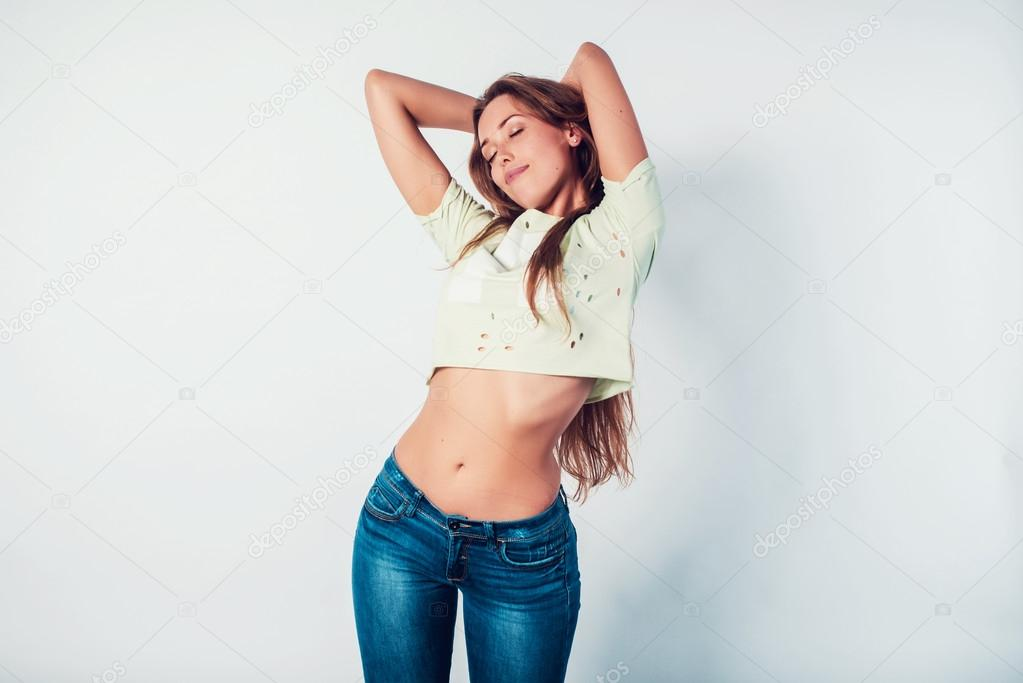 Happy young woman model standing playful in casual style