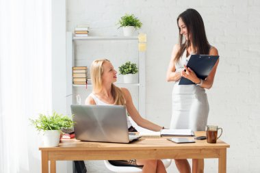 Two young woman colleague
