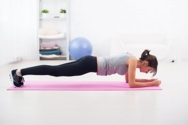 Fit girl in plank position