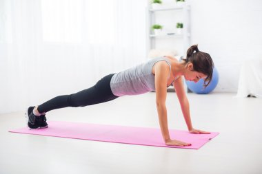 fit woman doing push-ups