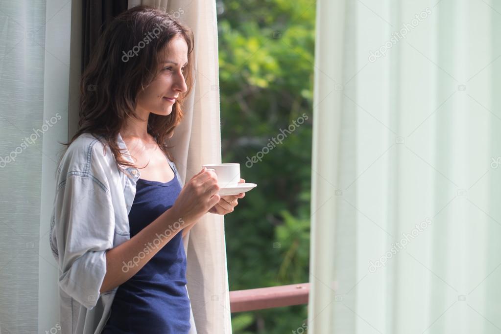 Woman in wide, long shirt
