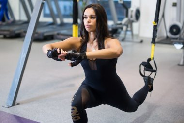 Athletic woman workout out squats