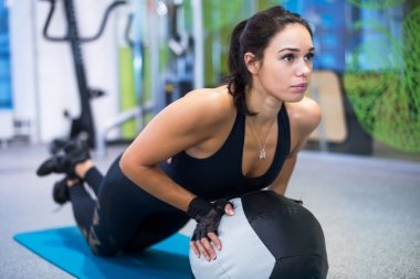 Fit woman exercising with medicine ball