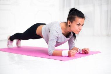 sporty fit sliming girl doing plank exercise