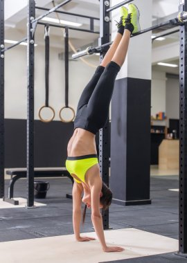 Fit woman doing handstand