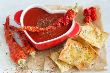 Spicy tomato soup with red pepper and cheese crisps