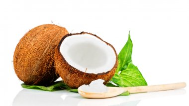 Coconut with wooden spoon