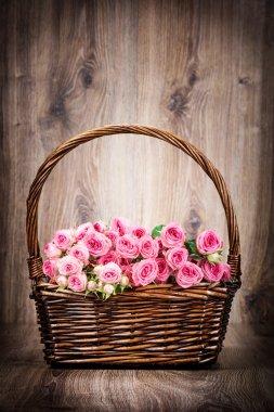pink roses flowers in basket