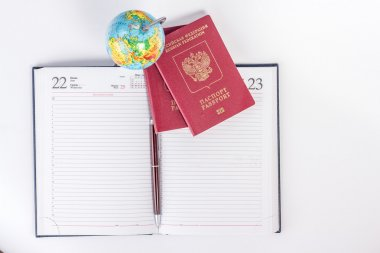 Opened lined diary with two passports