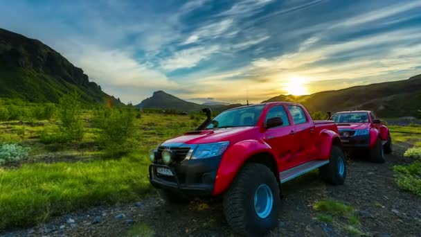 Off road vehicles in the sunset in Iceland