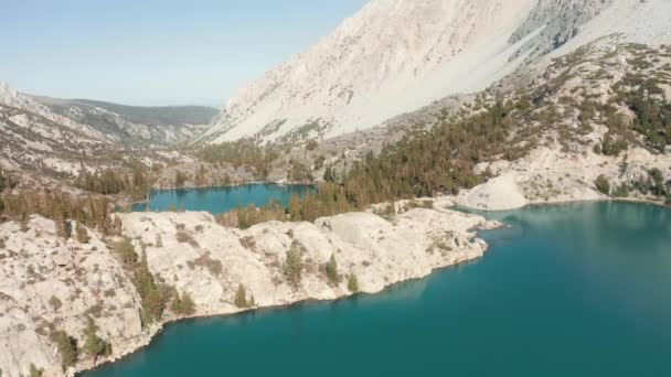 Aerial view of still blue water surface in glacier lake in the Sierra Nevada