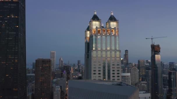 Cinematic close up illuminated historic architecture towers, Chicago background