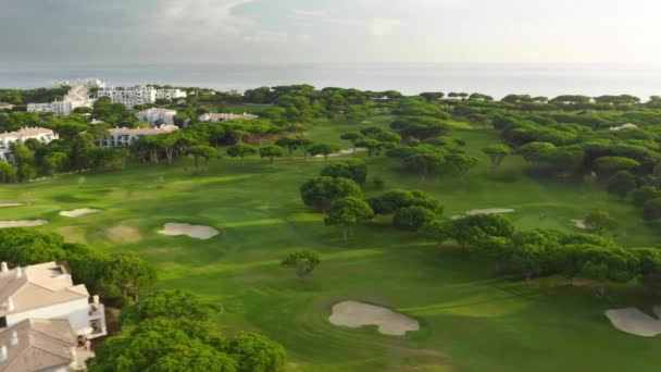 Lush golf courses with luxury, prestigious property in the background