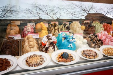 BARCELONA, SPAIN - FEB 9, 2014: Showcase of ice cream in window display at Rambla street in Barcelona Spain on Feb 9, 2014