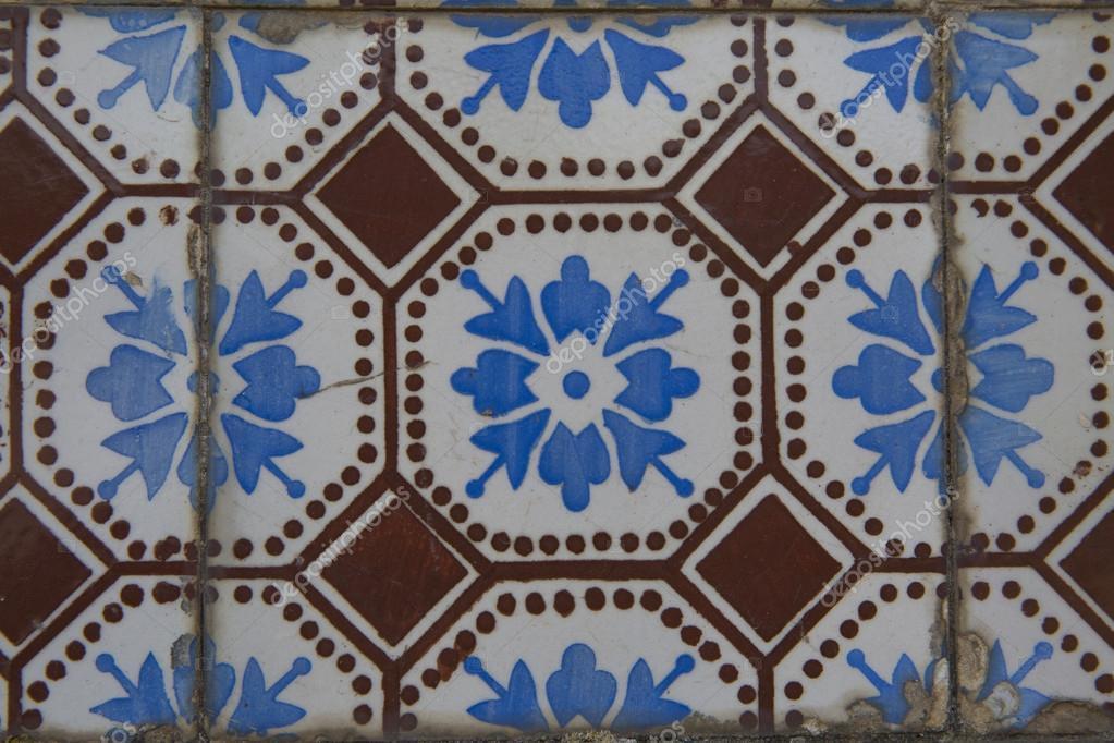Vecchie piastrelle in ceramica con configurazione astratta