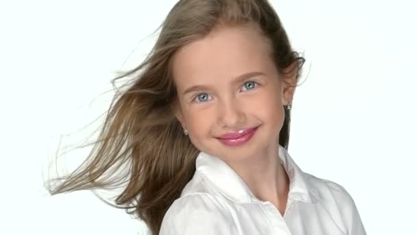 Teenage girl blonde smiling and posing  on white background,slow motion