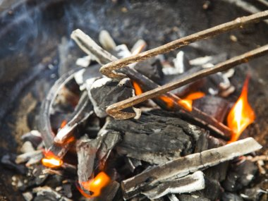 Preparation of fire for cooking