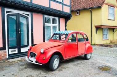 FINCHINGFIELD,ENGLAND-JULY 25,2015: Red oltimer Citroen 2cv6 Special car stands parked on the city roadside