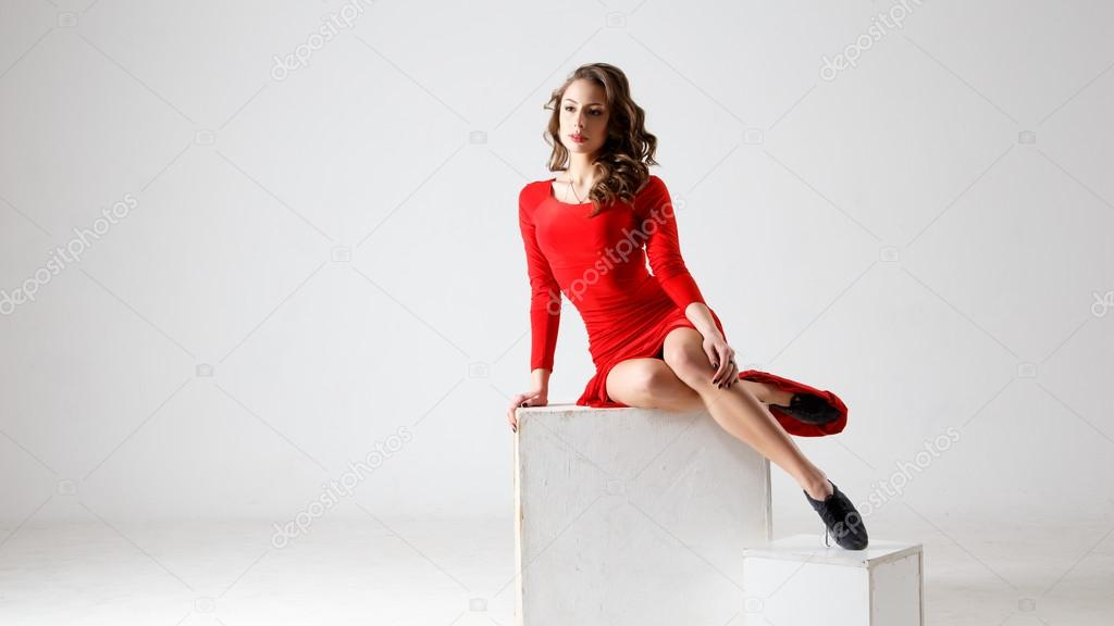 32bba0824 Dancing lady in a red dress. Contemporary modern dance on a white  background isolated. Fitness, stretching model– stock image