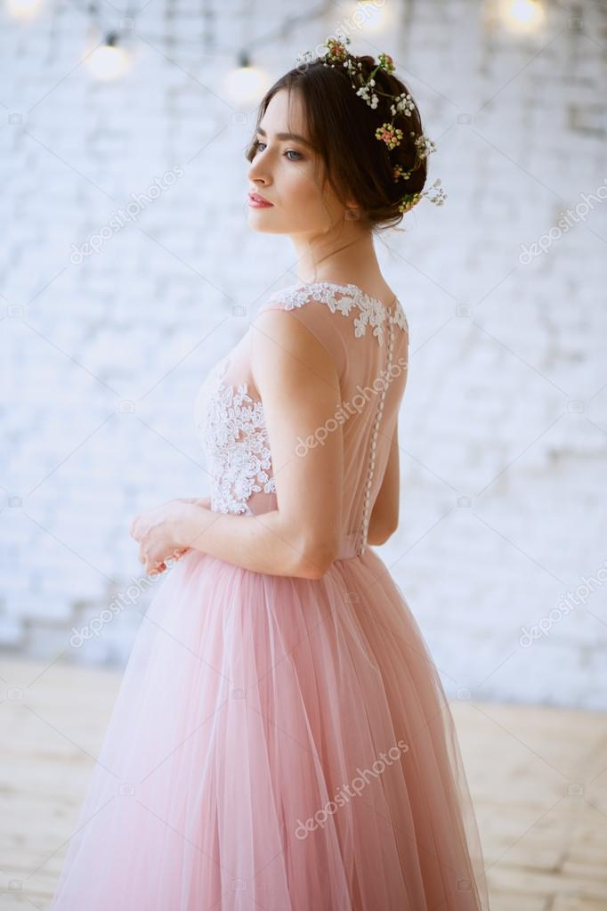 Bride in a tender light pink wedding dress in a morning. Fashion ...