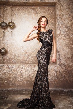 portrait of beautiful elegant young woman in gorgeous evening dress