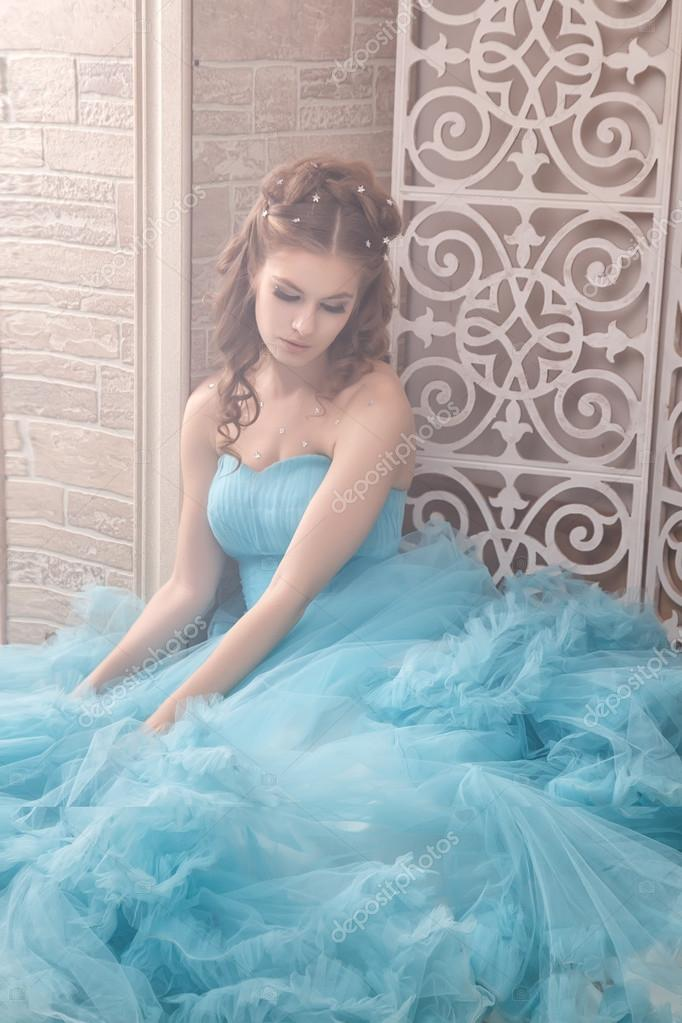 Beautiful Young Woman In Gorgeous Blue Long Dress Like Cinderella