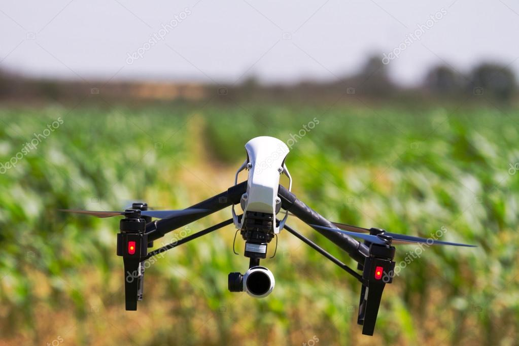Drone is flying over a green field