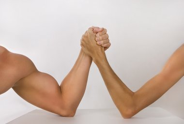 Two hands clasped arm wrestling (strong and weak), Unequal match