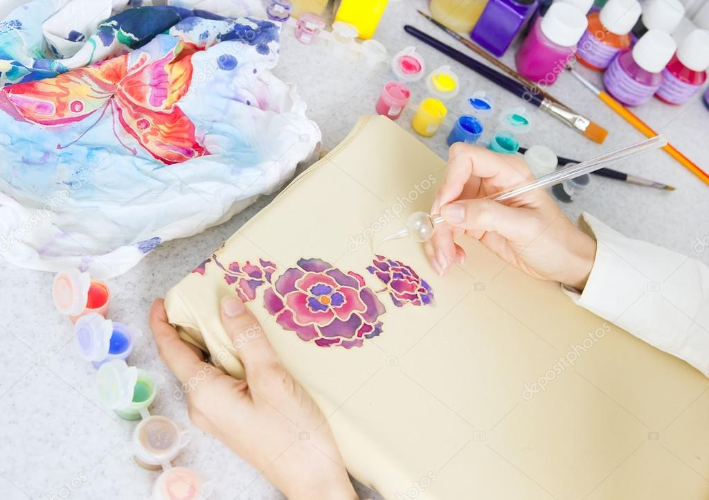 Batik process: artist paints on fabric, Batik painting