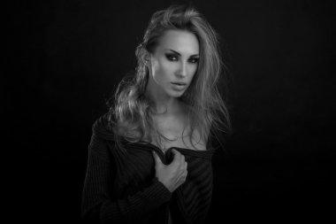 Beautiful Sexy Blond Woman. Dark Background. Smokey Eyes Makeup