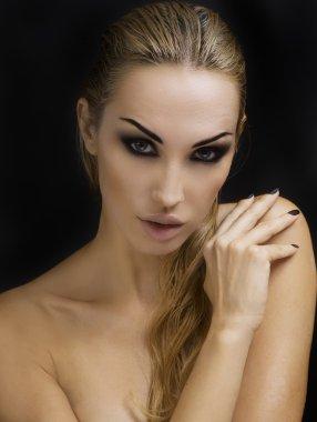 Beautiful Sexy Blond Woman. Dark Background. Bright Smokey Eyes