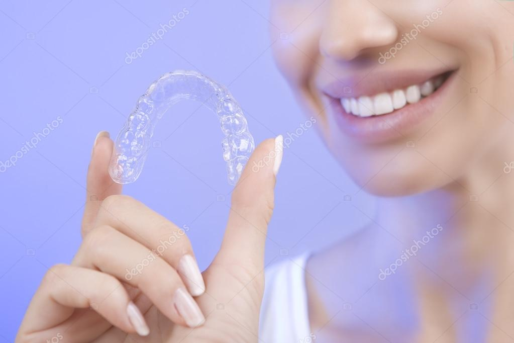 Beautiful Smiling Girl with Tooth Tray (hands Holding Individual Tooth Tray), Methods of Teeth Teeth Whitening and Correction, Close-up (blue filter effect)