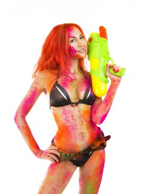 Happy Holi Festival! Holi Celebration Party - Beautiful Sexy Caucasian Girl in bikini with toy gun colored Dry Bright Multicolor Paint Powder on White background keep Indian traditional spring color Festival stock vector