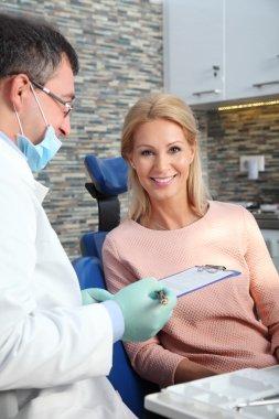 dentist holding  clipboard