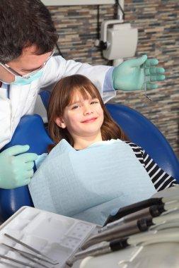 girl has a dental examination