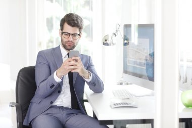 assistant using his mobile phone