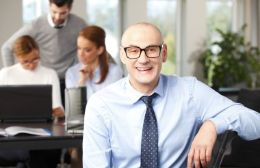 Financial officer sitting at office
