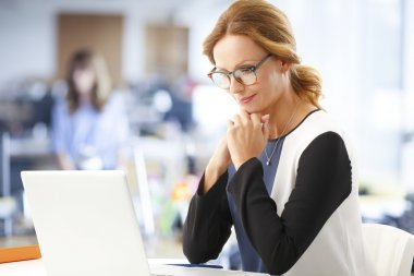 Businesswoman sitting in front of laptop