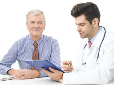 Male doctor with elderly patient