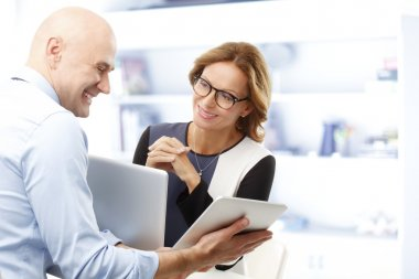 Businessman analyzing data with businesswoman