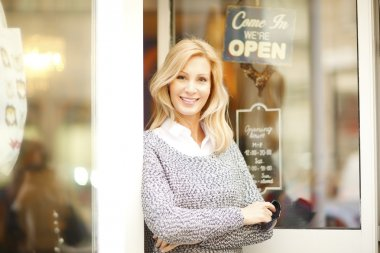 female owner at shop facade