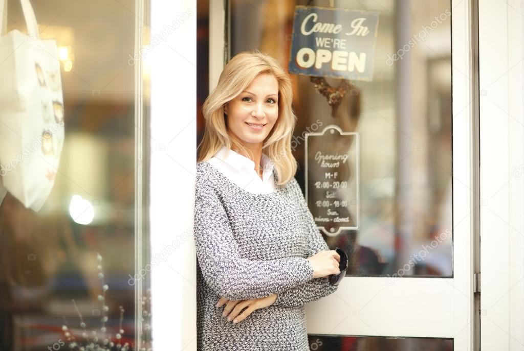 woman in front of small vintage store