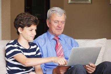 boy helping grandfather.