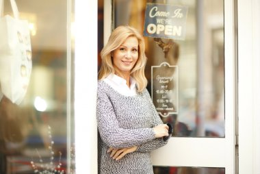 store owner standing at shop facade