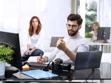 graphic man sitting at studio