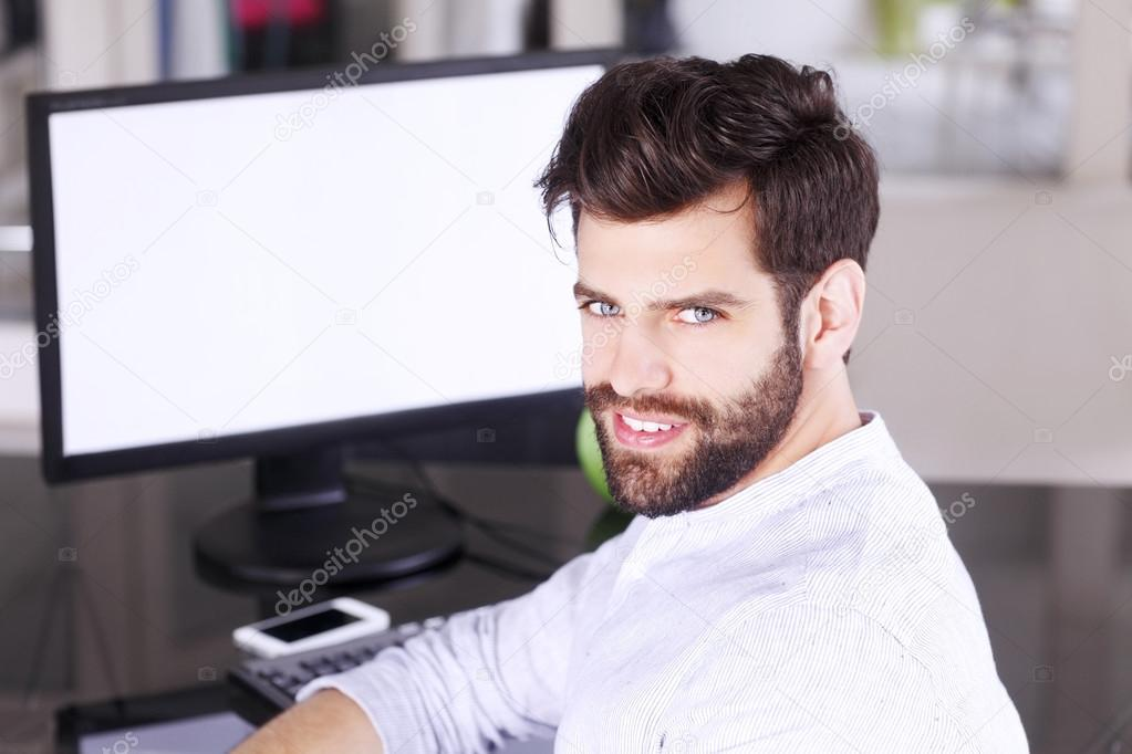Man in front of computer screen — Stock Photo © Sepy #77834598